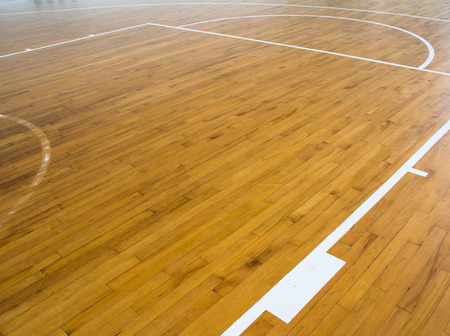 gymnasium: wooden floor basketball court with light effect Stock Photo