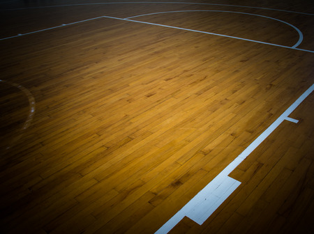 playground basketball: wooden floor basketball court with light effect Stock Photo