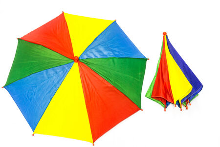 converging: Colorful umbrellas on white background