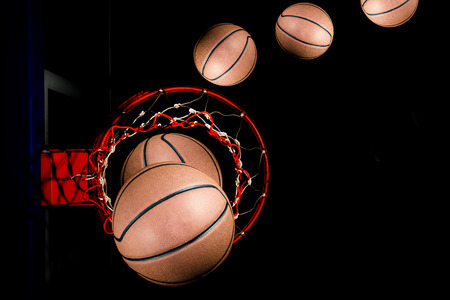 Basketball on  black background with light effect photo