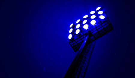 Stadium floodlights on a sports field at night photo
