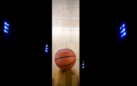 Basketball court floor as a sports ,with floodlights photo