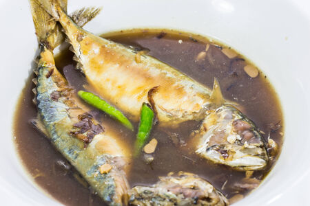 mackerel fish boiled with Thai native sauce photo