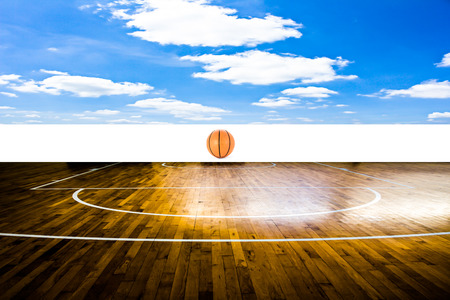 Basketball court with blue sky photo