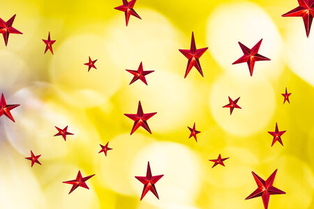 Red star on  abstract bokeh background of Christmas light photo