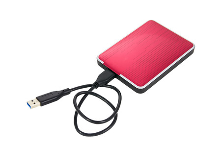 portable hard disk: Red external hard drive on white background