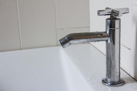 washbasin: washbasin and faucet in bathroom