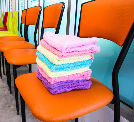 Stack of towels on chairs Stock Photo
