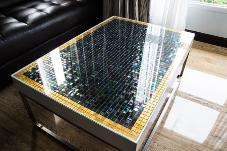 accommodation space: Table mosaic in living room . Interior design.