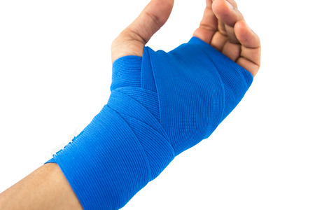 Hand tied blue elastic bandage on a white background Stock Photo