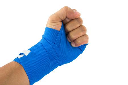 white bandage: Hand tied blue elastic bandage on a white background Stock Photo