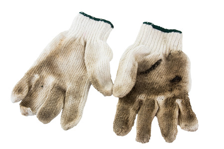 Dirty gloves isolated on a white background. Stock Photo