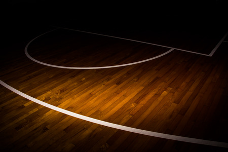 hoop: wooden floor basketball court with light effect Stock Photo