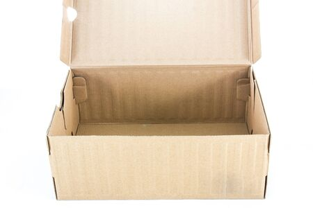 tilt view: Open small cardboard box isolated on white background. Tilt view.