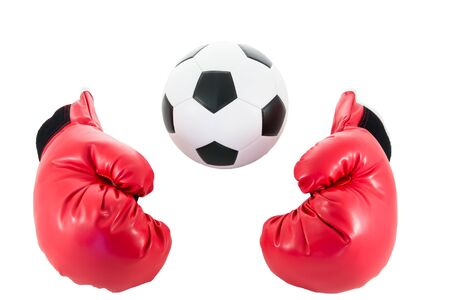 boxing equipment: soccer ball with red boxing glove isolated on white background Stock Photo