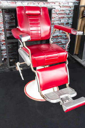 barber chair: vintage barber chair over brick wall