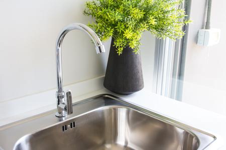 steel: Water tap with sink in  modern kitchen.
