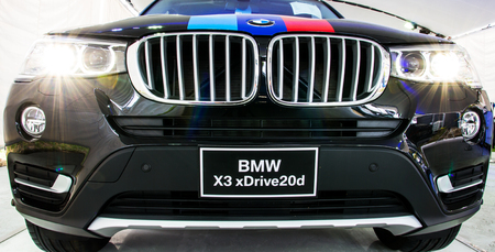 motor car: HATYAI, THAILAND - AUGUST 12, 2015: New model BMW X3 xDrive20d against modern design surface. Editorial