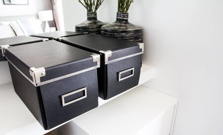 Black storage boxes in a room