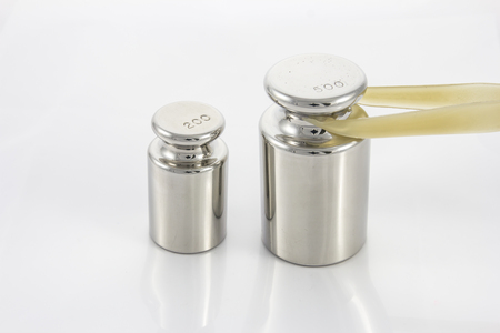 heaviness: Calibration weight on white background
