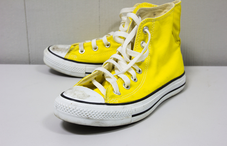 shoe string: yellow shoes on a wooden floor