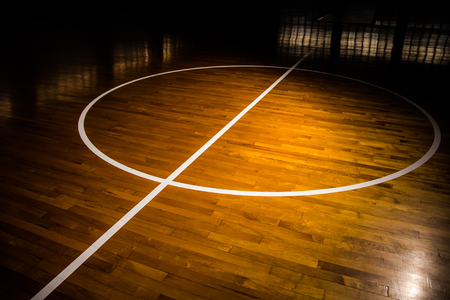 court: wooden floor basketball court with light effect Stock Photo