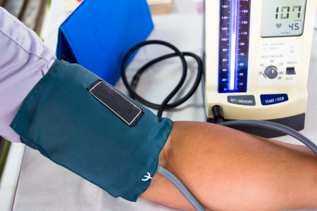 high blood pressure: doctor is investigating the blood pressure of a patient.