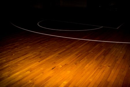 wooden floor basketball court with light effect Stock Photo