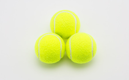 chartreuse: Close up tennis ball on white background