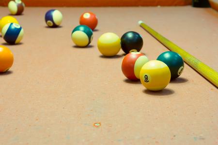 snooker halls: Billiard balls in a old pool table