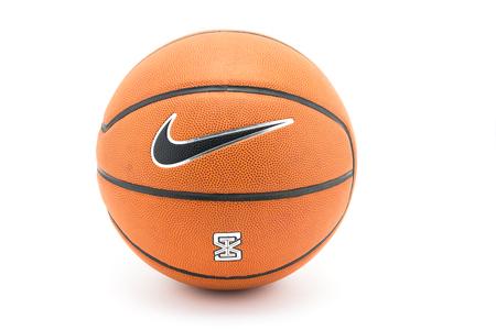 nike: BANGKOK, THAILAND - MARCH 13, 2016: Logo of the brand  Nike on basketball ball Editorial