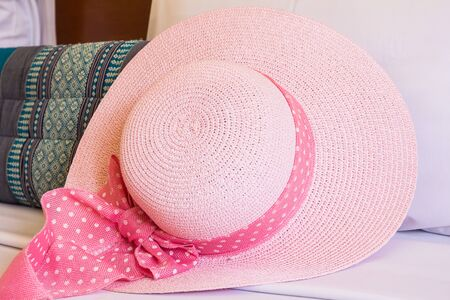 pink hat: Pink hat on couch Stock Photo
