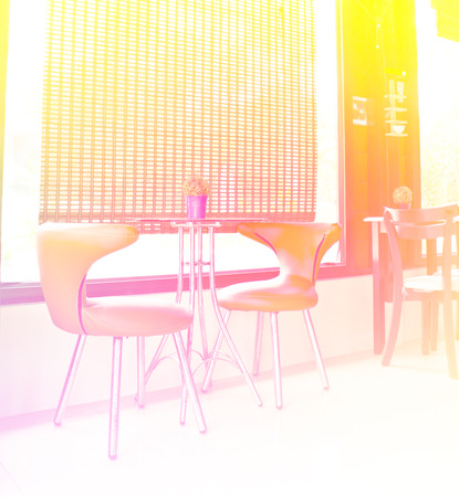 orange chairs: table and orange chairs Stock Photo