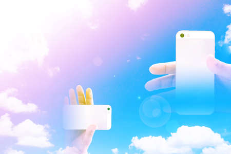 Blur smart phone on blue sky background Stock Photo