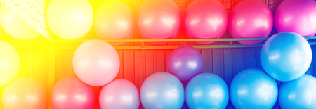 muscle toning: yoga balls in the gym with color filter