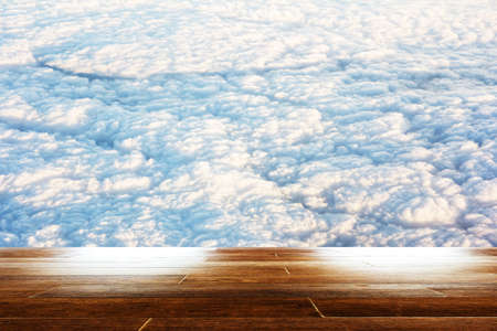 nebulosity: blue sky with cloud closeup as background with wooden