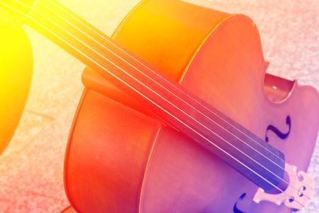 violoncello: Violoncello in music room with color filters Stock Photo