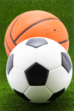 penalty: soccer ball with basketball on green grass background