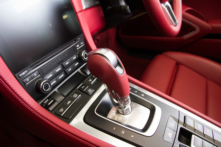 inwards: Luxury car Interior - steering wheel, shift lever and dashboard