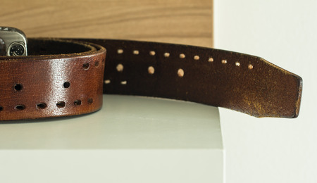 clasps: Brown leather belt
