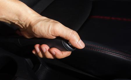 inwards: Pulling handbrake.Car Interior