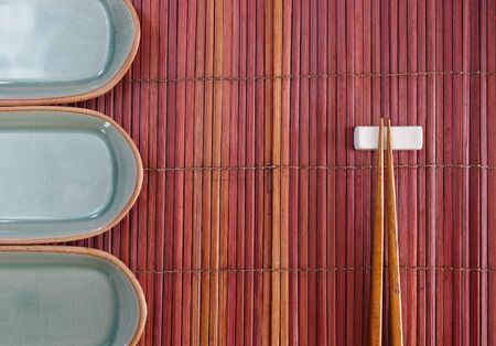 Chopsticks in asian set table photo