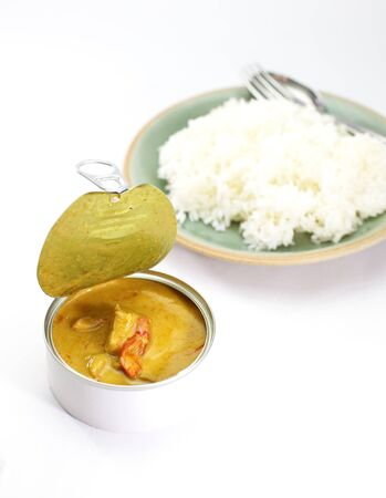 Yellow curry in can with rice photo