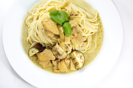 Spaghetti with green curry photo