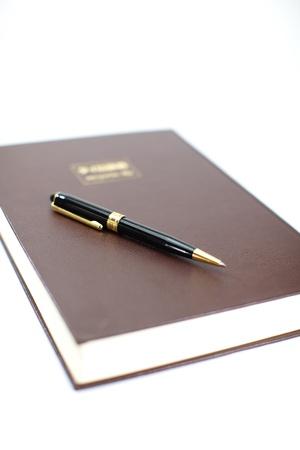 本をペン 写真素材