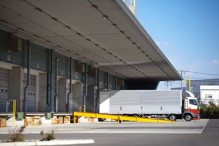 food distribution: Truck at warehouse loading bay