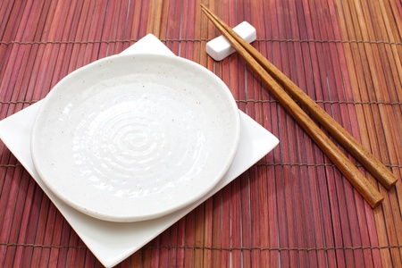 White empty plate with chopsticks Stock Photo - 17663171