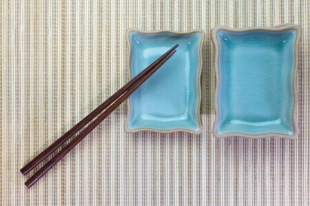 Chopsticks and Asian table setting photo & Chopsticks And Asian Table Setting Stock Photo Picture And Royalty ...