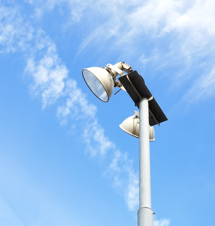 Tall modern floodlights against a bright blue sky  photo