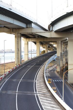 A colossal concrete motorway flyover access and egress photo